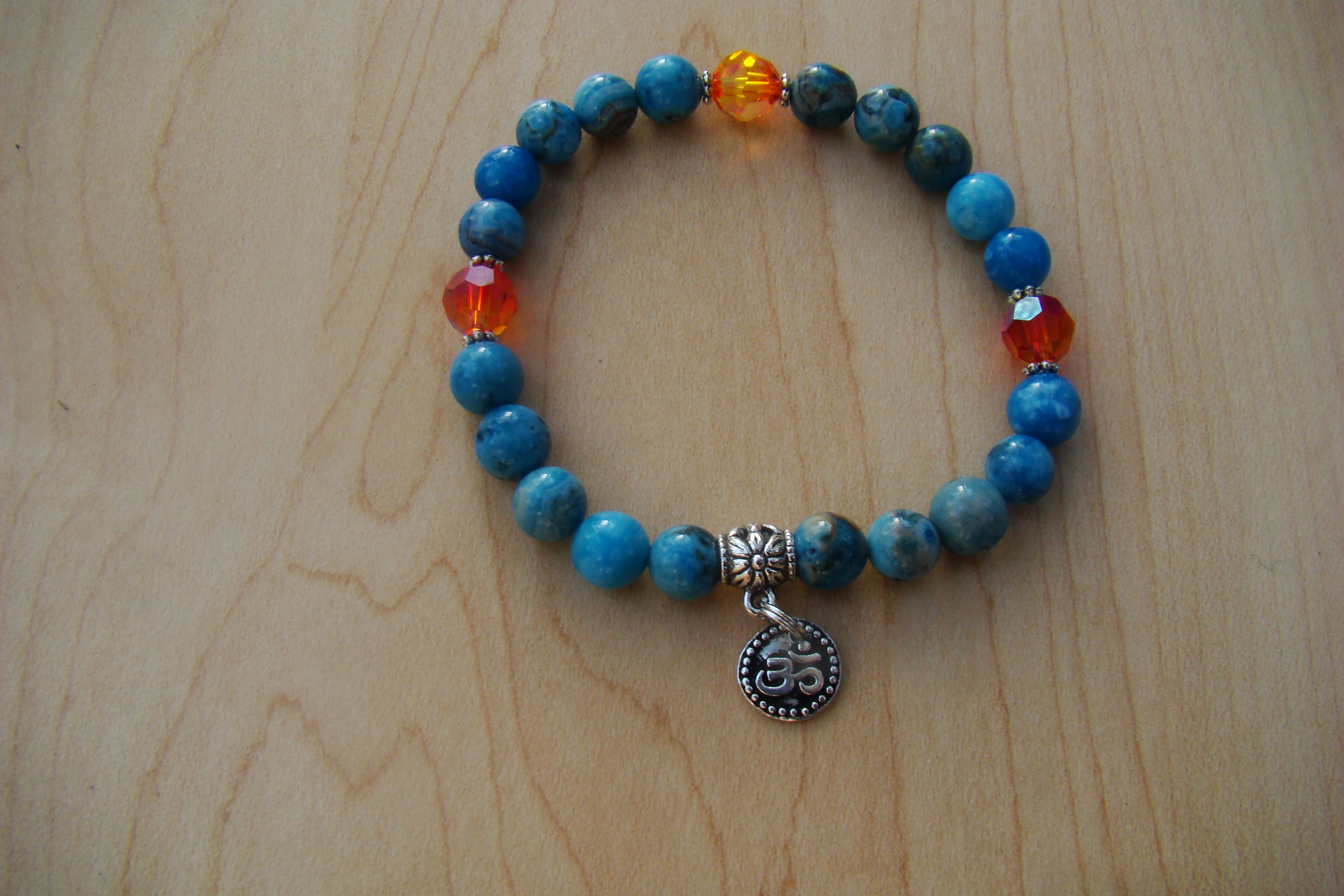 Blue Crazylace Agate with an OM Symbol